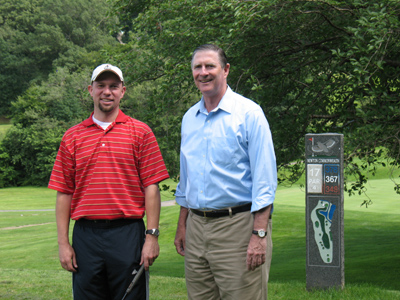 Lisle with golfer at the Newton Commonwealth Golf Course