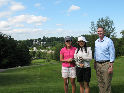 Lisle with two golfers at the Newton Commonwealth Golf Course